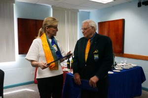 Sophie, Countess of Wessex being presenting with a scarf and tie from Mr. Steve Stoute, President of the Barbados Olympic Association