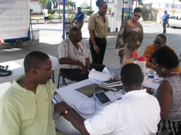 ESSO customer Wayne Cadogan receiving his blood pressure test at the Hastings Station.