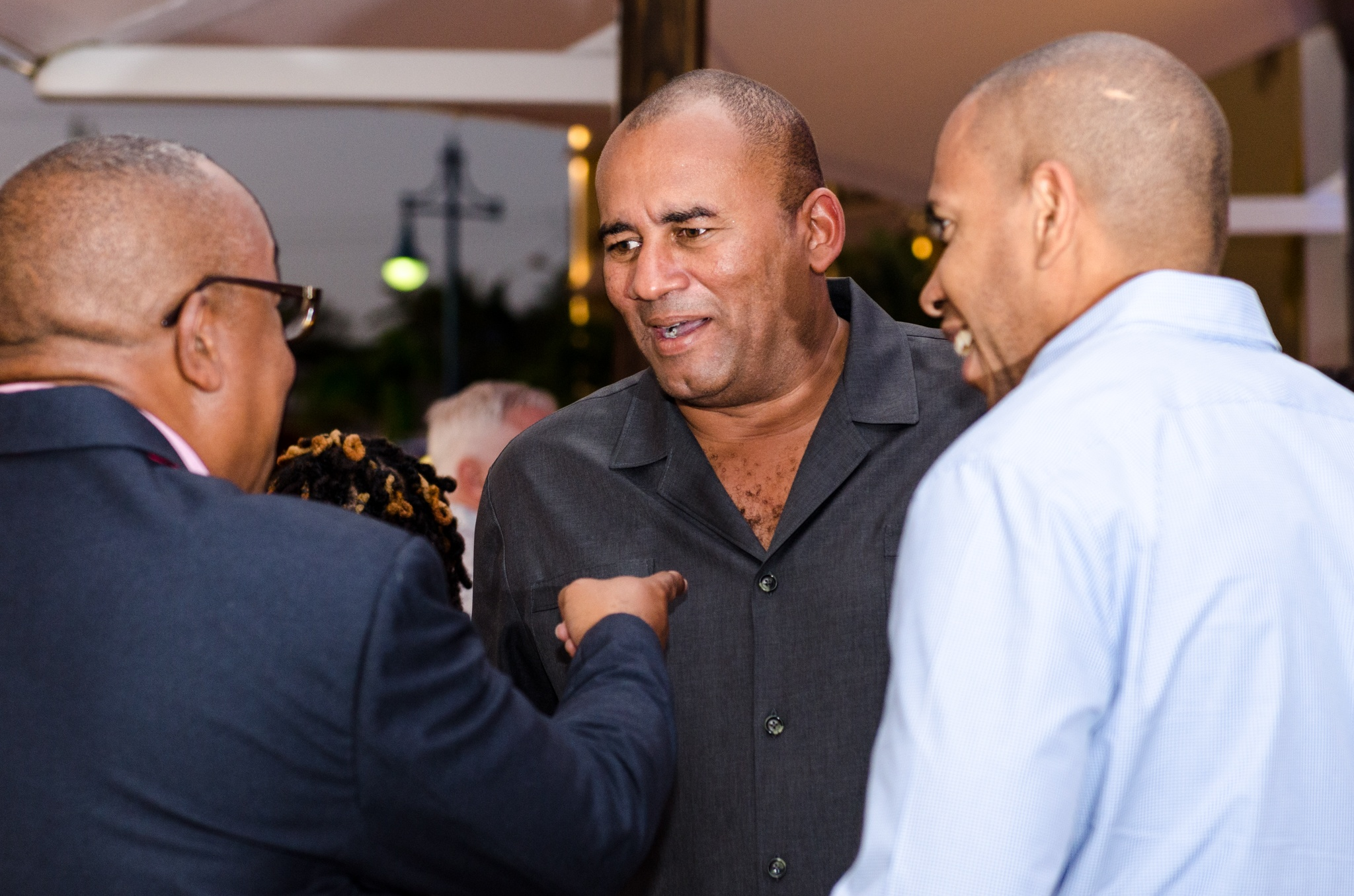 The Hon. Richard Sealy, Minister of Tourism sharing a joke with David Noel and guest