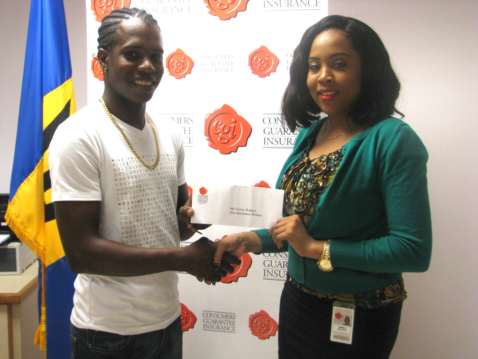 Karla Yearwood of CGI presenting Corey Walters with his prize
