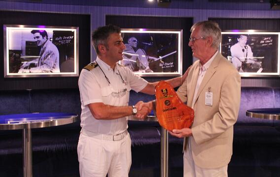 Captain Catalani and Michael Weetch. Officials at the Bridgetown Port welcomed the Carnival Sunshine on its inaugural visit to Barbados last Friday.