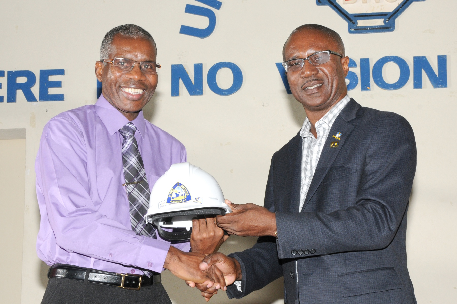 David Jean-Marie, CEO Barbados Port Inc presenting a helmet to one of the awardees