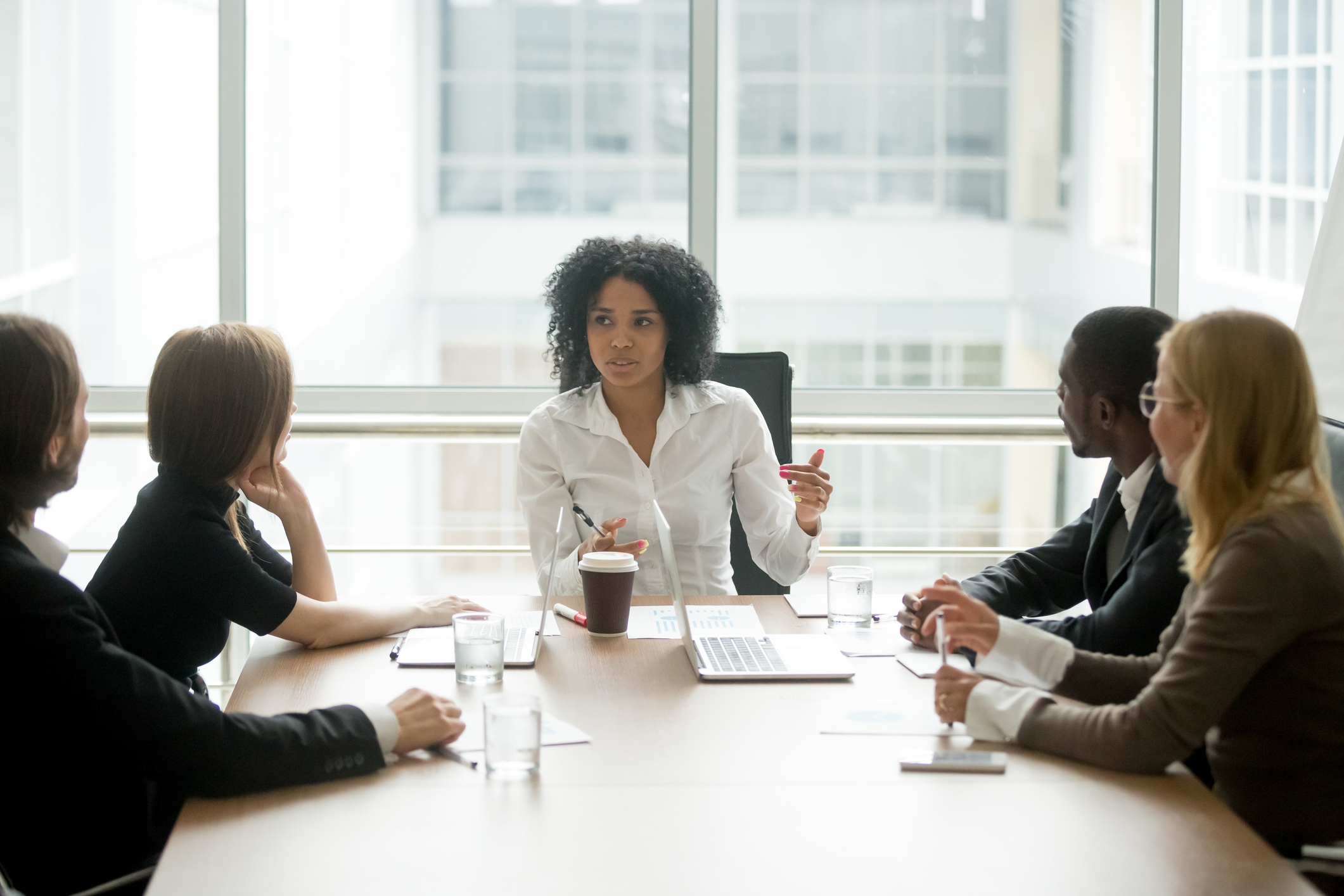 Black-female-boss-leading-corporate-meeting-talking-to-diverse-businesspeople-923039680_2125x1416